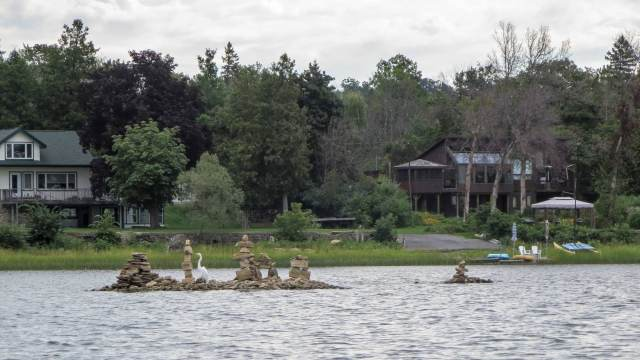paddling in cottage country - houses on the Quebec shore of the Ottawa