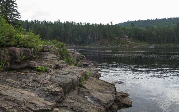 the put-in at the bottom of Chute Au Diable - hunter's camp/cottage on opposite shore