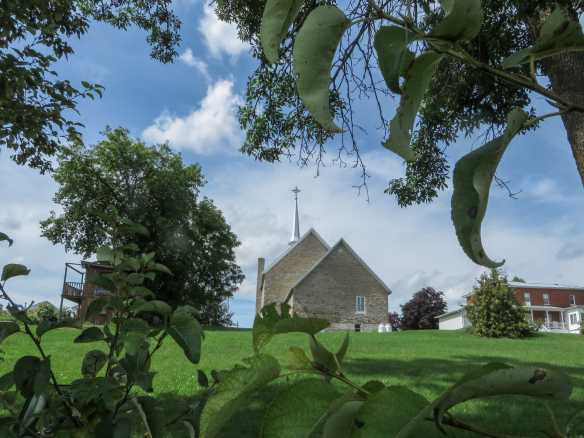 the view of the church from our La Passe lunch spot on the banks of the Ottawa River