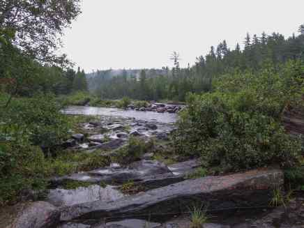 looking-from-tall-pine-portage-at-the-rapids-on-a-wet-afternoon