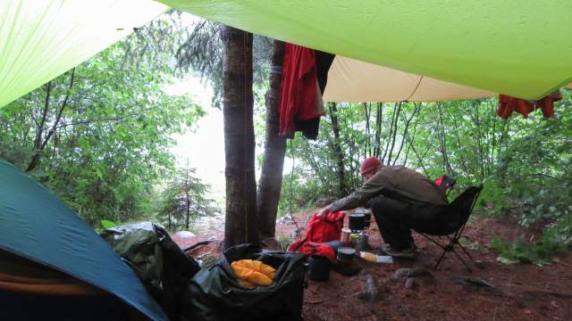 max-tending-the-cook-stoves-at-tall-pine-rapids