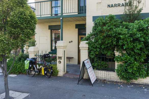 my loaded Surly bike in front of the Narrara Backpackers' Hostel in Hobart