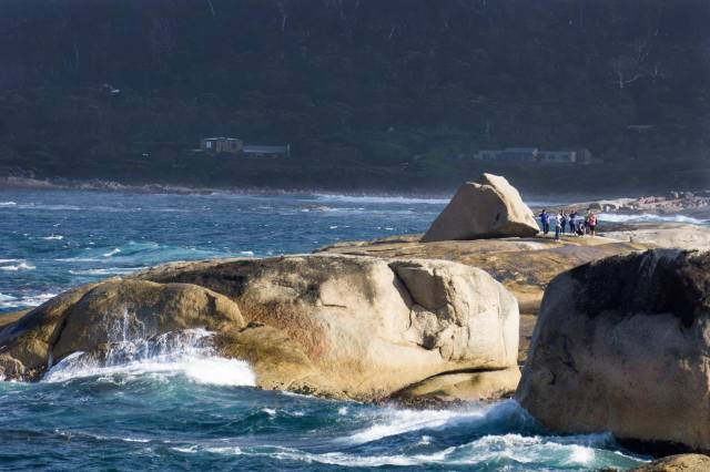tourists waiting by the Blowhole on the Bicheno shore