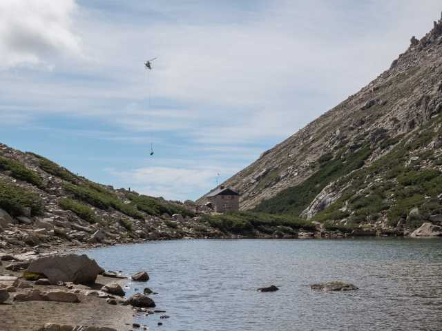 a view of the helicopter drop from the side of Laguna Toncek