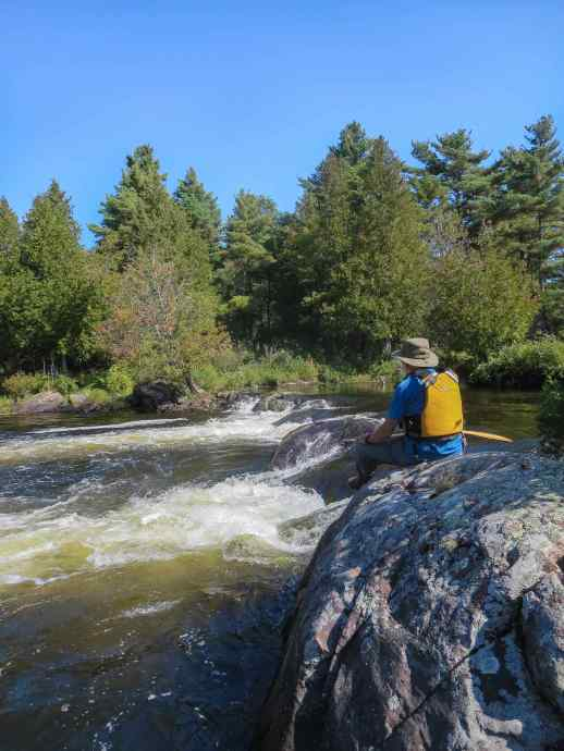 checking out the flow of the one set of rapids on the Old Voyageur Channel