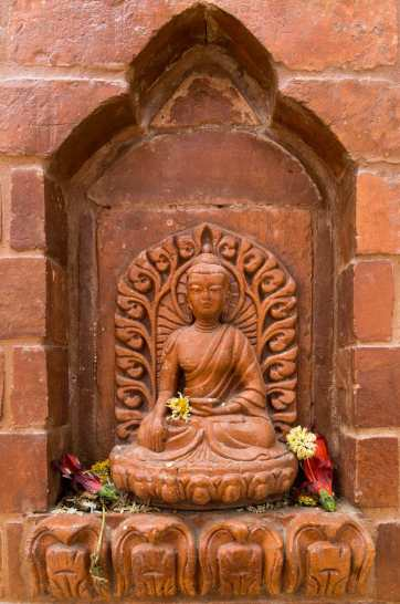 Buddha figure in wall niche at Boudnath