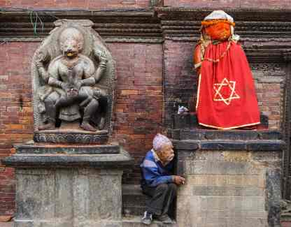 Hanuman and draped figure on Lalitpur's Durbar Square
