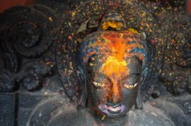 head of Buddha figure in street shrine Kathmandu