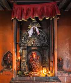 Lalitpur - Mahakala figure with offerings